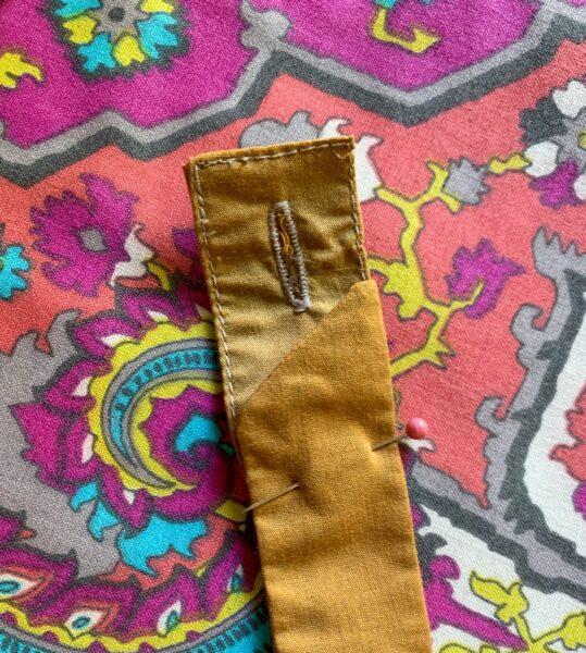 Pinning end of sleeve garter to belt