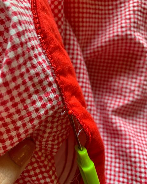 picking off front pocket with seam ripper