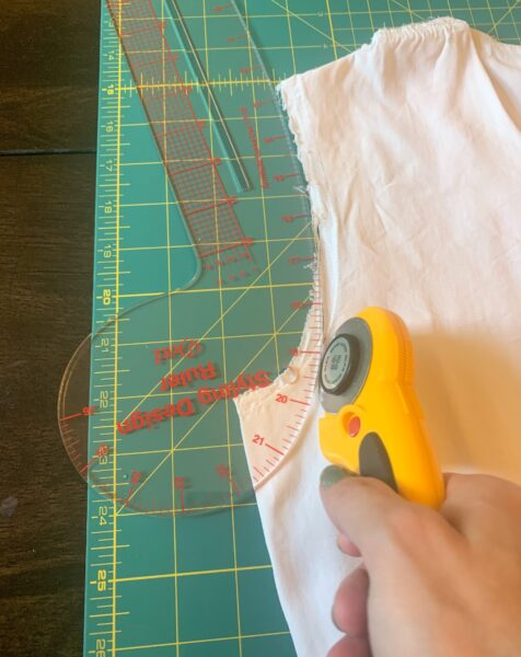 expanding armhole with french curve and rotary cutter