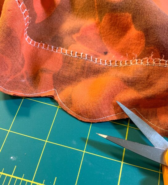cutting fabric from edge of scallops