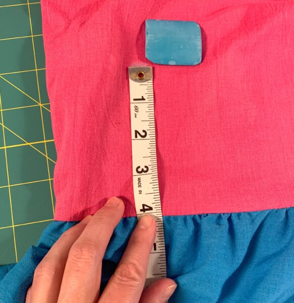 "marking and measuring 4"" on bodice"