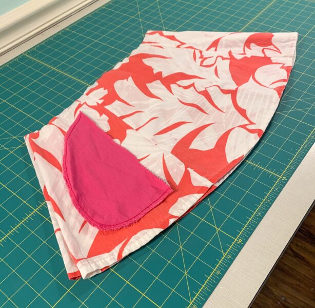 laying pocket template over fabric