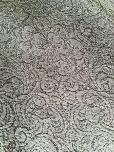 closeup of green fabric revealing brocade pattern