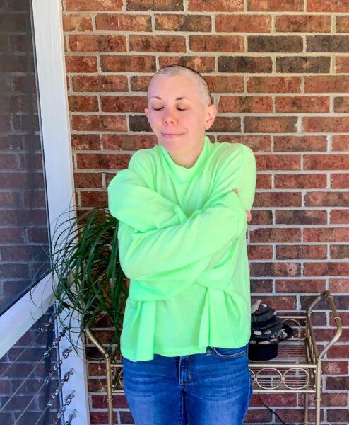 refashionista cuddled in sweatshirt