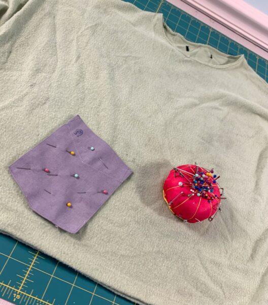 pinning pocket to shirt