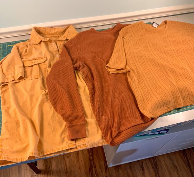 three orange shirts