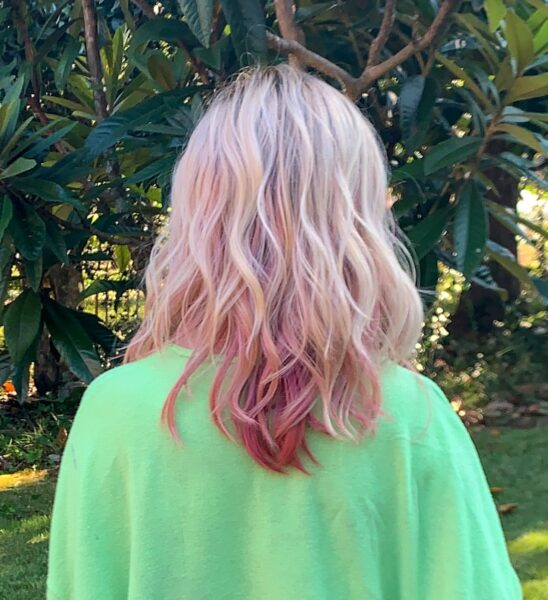 back of wig showing pink highlights