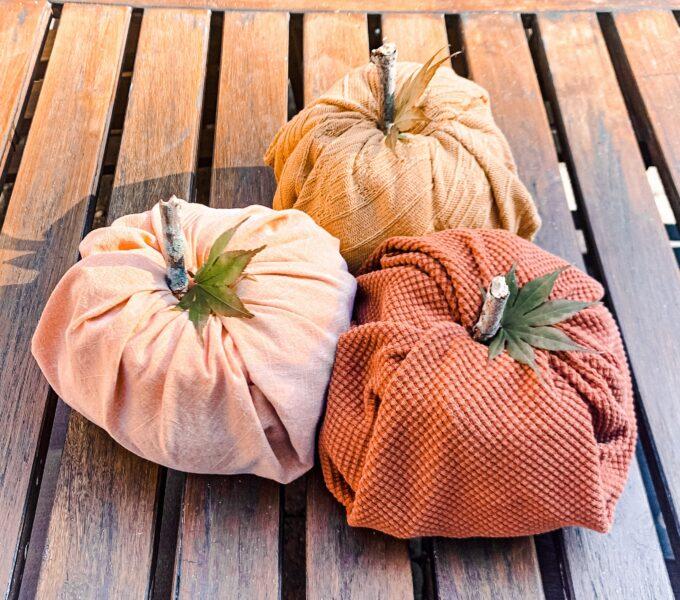 fabric pumpkins on table
