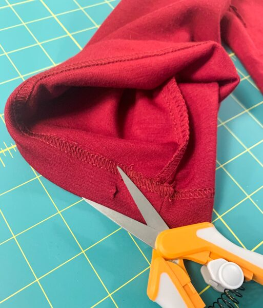 snipping bottom sleeve to make elastic casing
