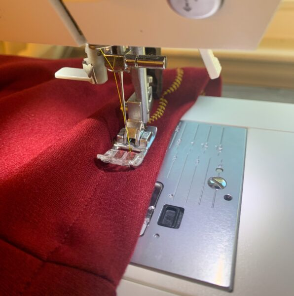 sewing decorative stitch along bottom hem