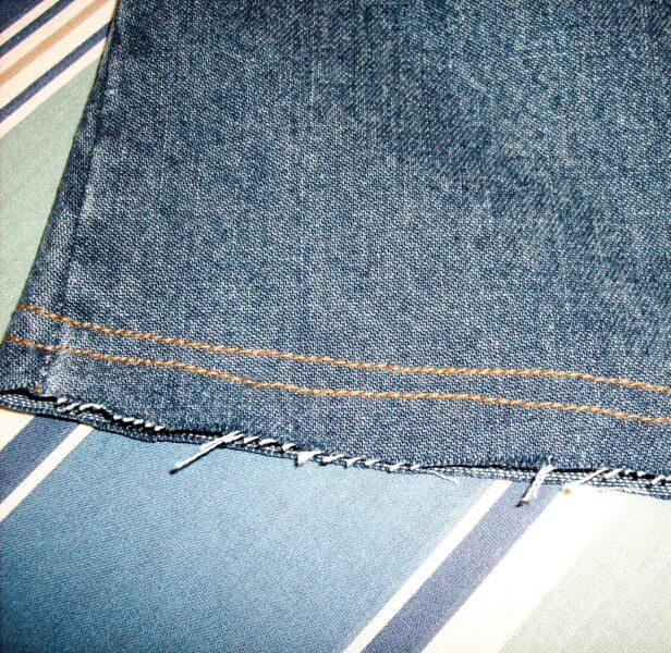 close up of bottom frayed hem and stitching