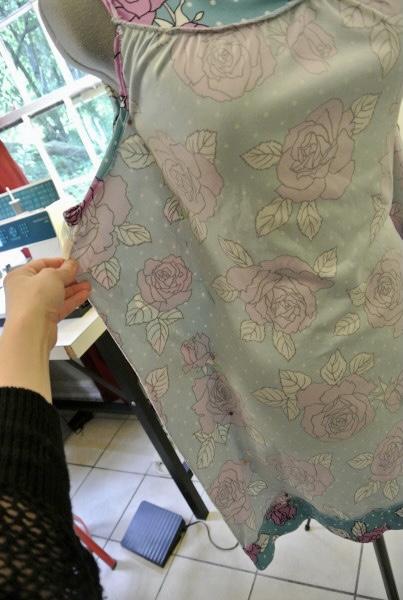 pinning dress on dress form