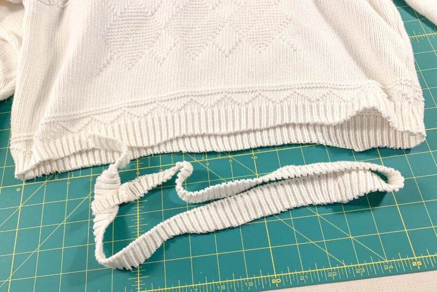 cutting off bottom of sweater