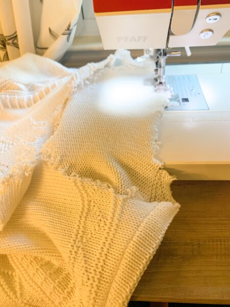 sewing neck of sweater