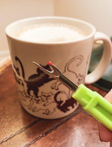 cat orgy mug and seam ripper