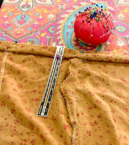 pinning new hem for dress
