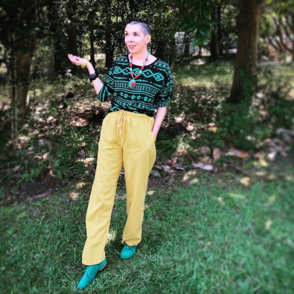 refashionista with shaved head in bright outfit