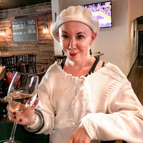 jillian in white sweater and matching beret