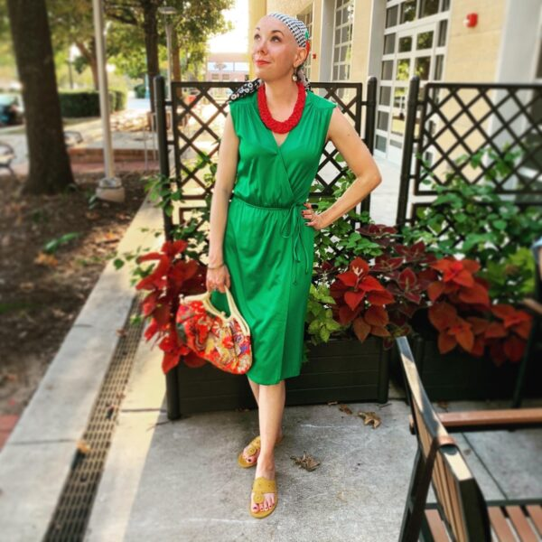 refashionista in green '70s vintage dress, red vintage necklace, and vintage headscarf