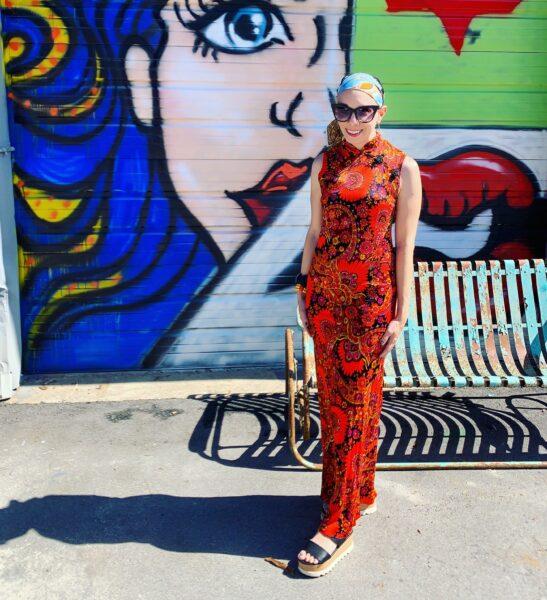 refashionista in brightly patterned vintage dress and headscarf