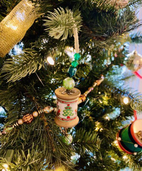 closeup of thread spool ornament