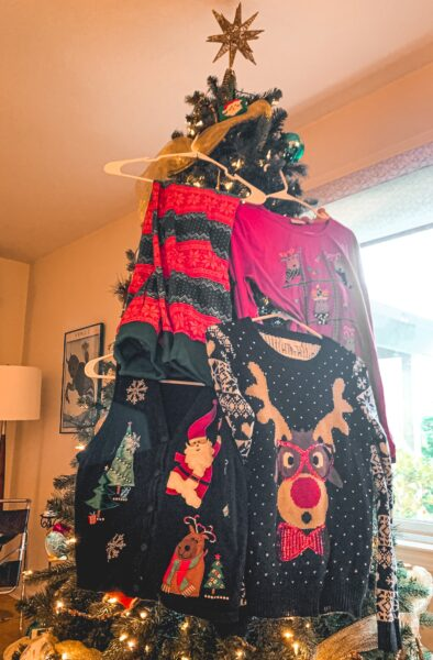 christmas sweaters hung in christmas tree