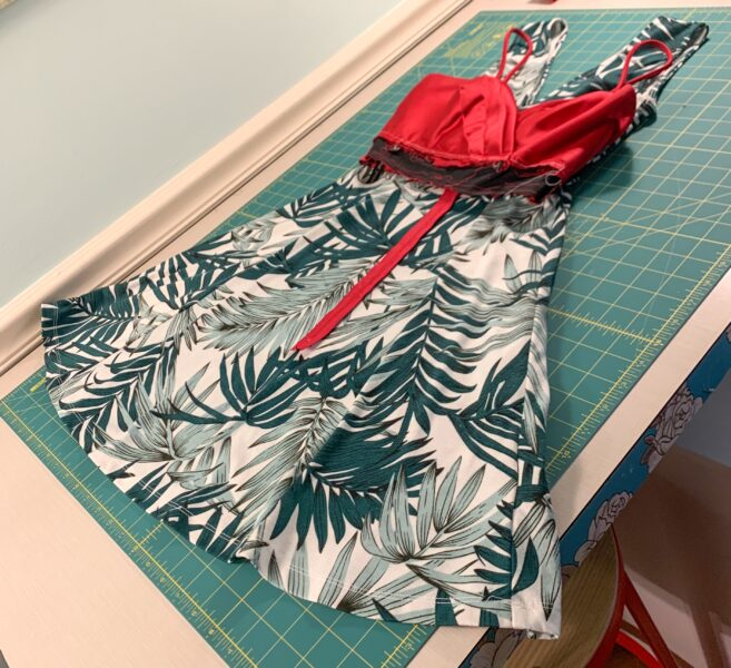 bodice of red dress laid over fit and flare dress