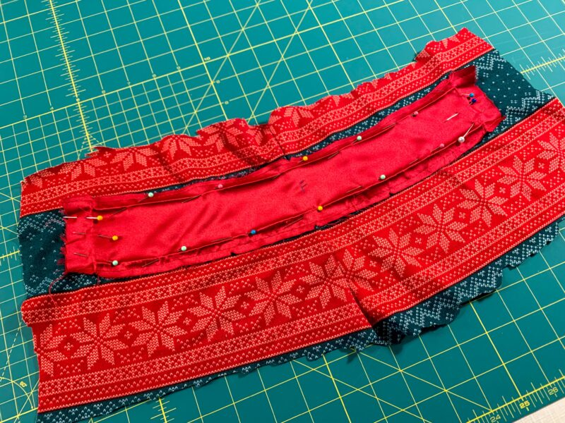 piece of belt thing pinned to jogger fabric