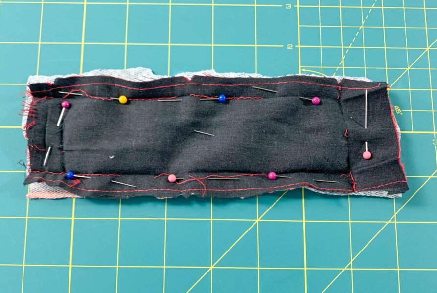 pinned fabric on piece of belt thing