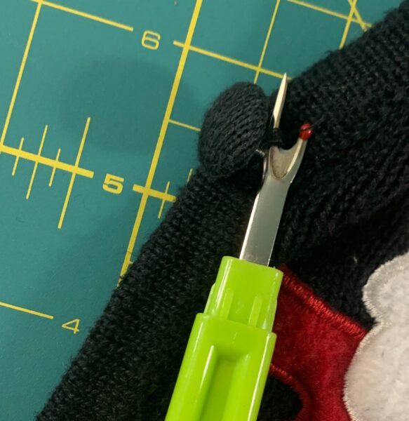removing button with seam ripper