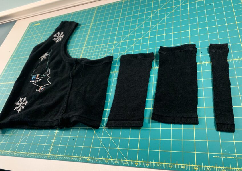 cutting fabric from the back of the vest