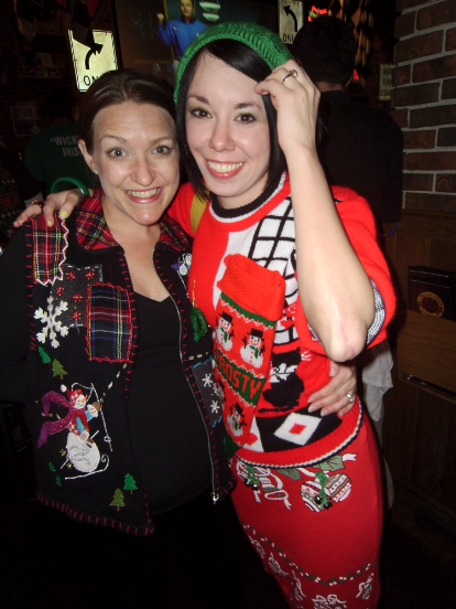 Jillian and friend in ugly Christmas Sweaters