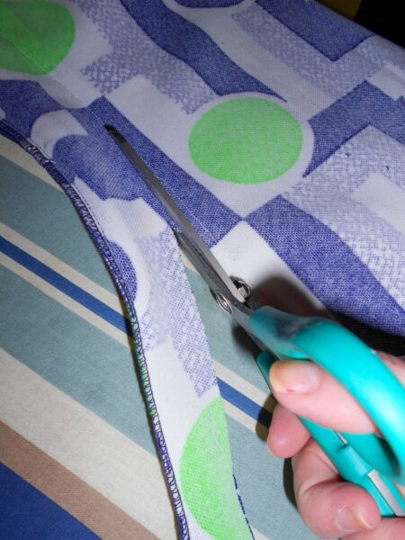 removing excess fabric with scissors