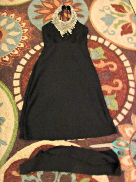 dress on floor with bottom part cut off