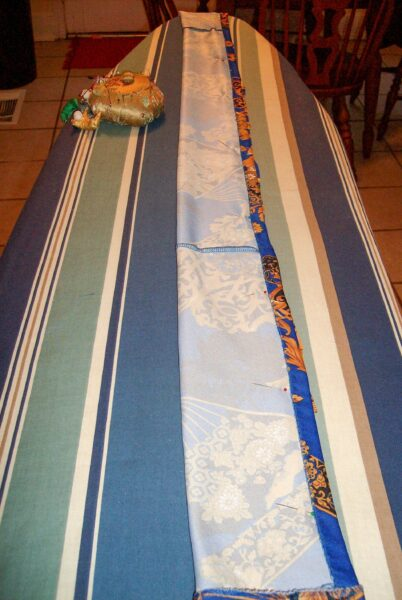 pinned sash on ironing board