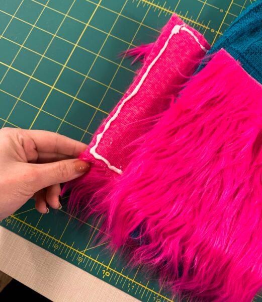 gluing vertical side of fur