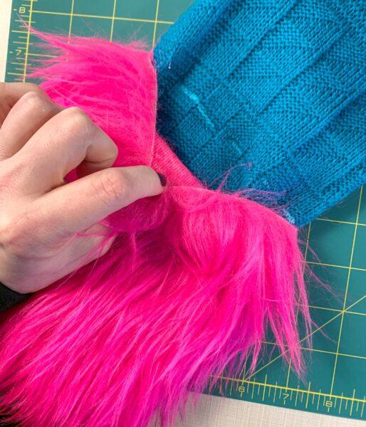 fur peeling away from sweater