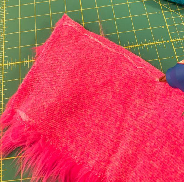 adding hot glue to fur