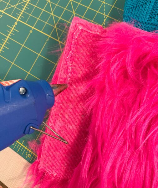 hot gluing fur to sweater