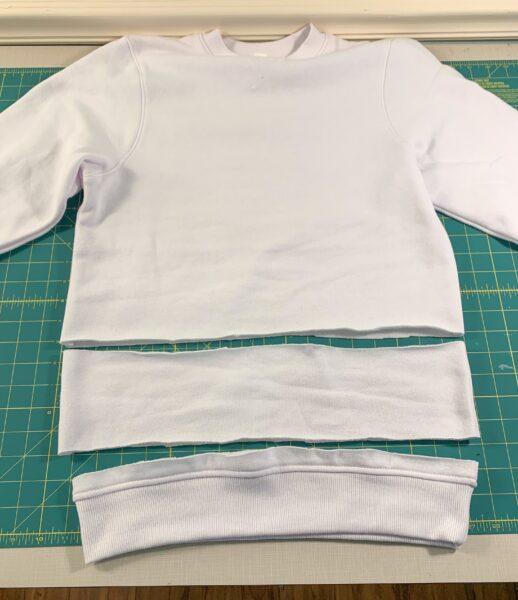 cutting off bottom band of sweatshirt