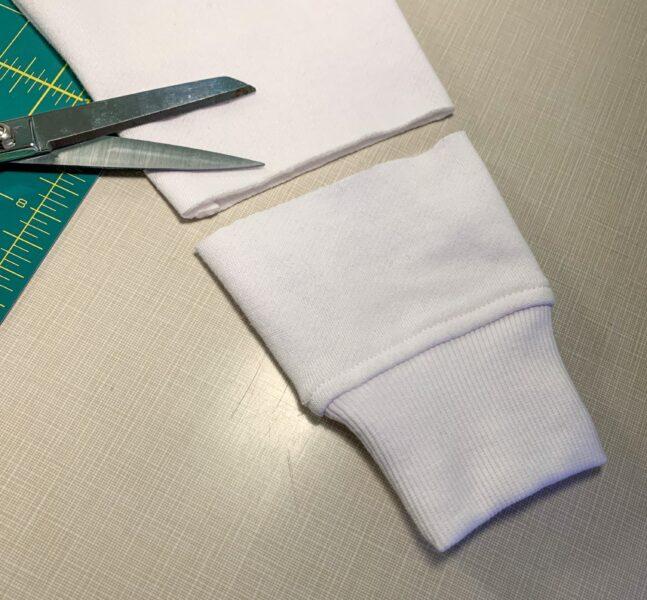 cutting off sleeve of sweatshirt