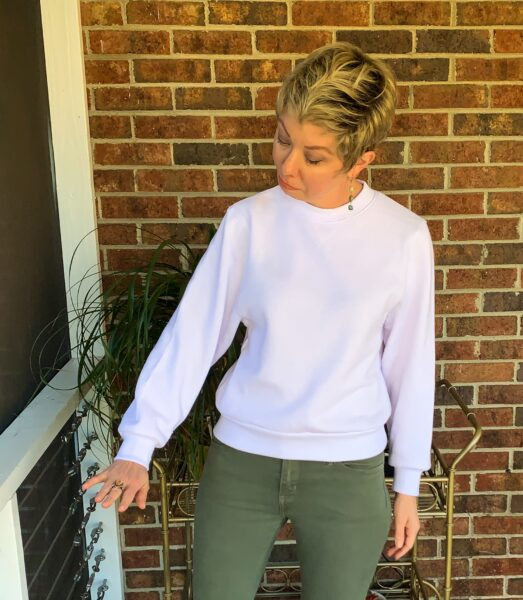 refashionista looking at shortened sleeve