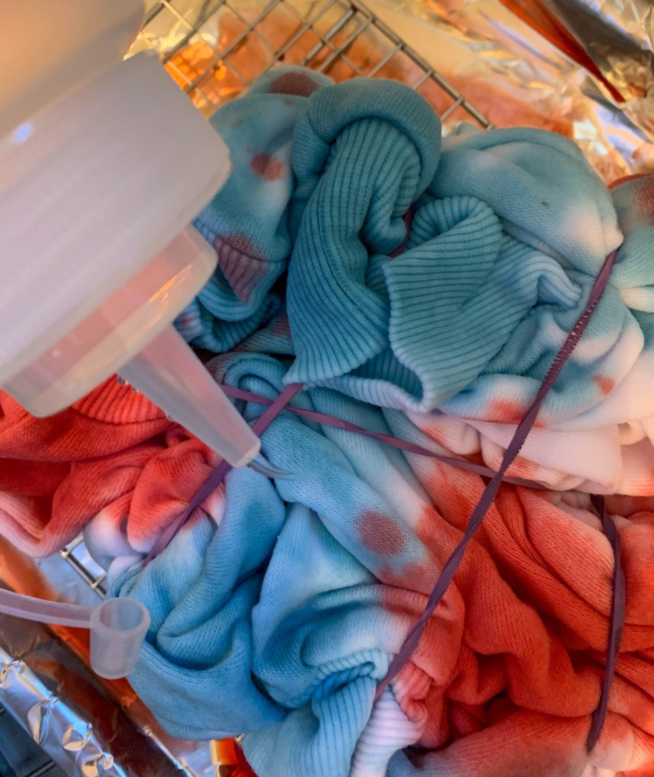 covering shirt in dye fixative