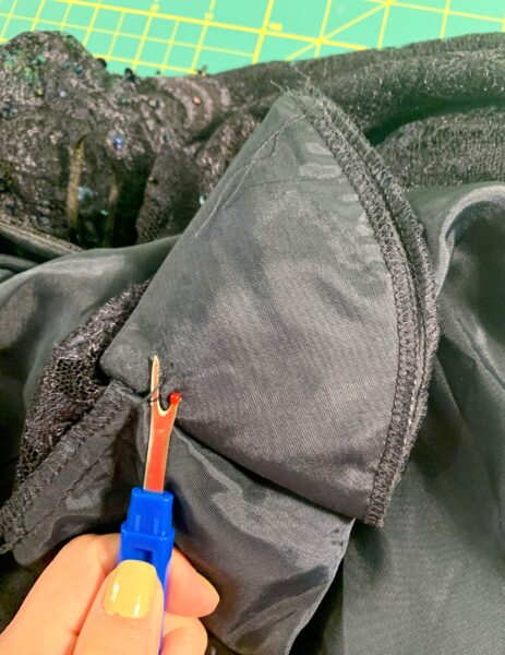 removing shoulder pad with seam ripper