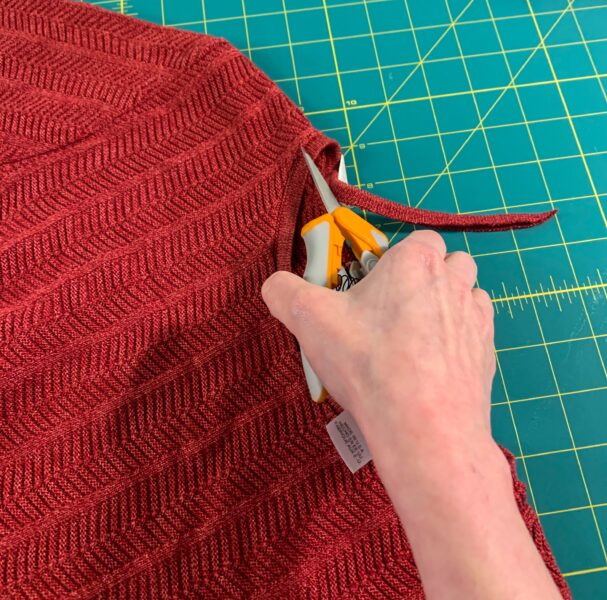 cutting out neck of sweater
