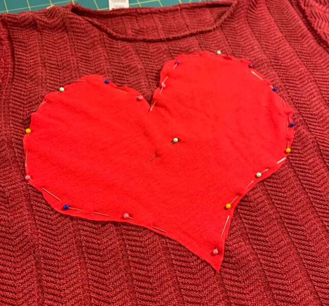 pinned heart to back of sweater