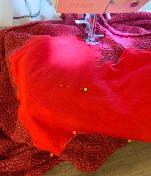sewing heart onto shirt