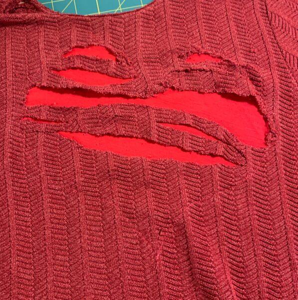 cutting slashes into shirt
