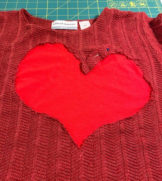 pinned shred on outline of heart