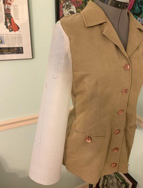 sleeve pattern piece pinned on jacket